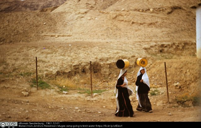 Women from Jericho's Palestinian refugee camp going to fetch water by Romain Swedenburg