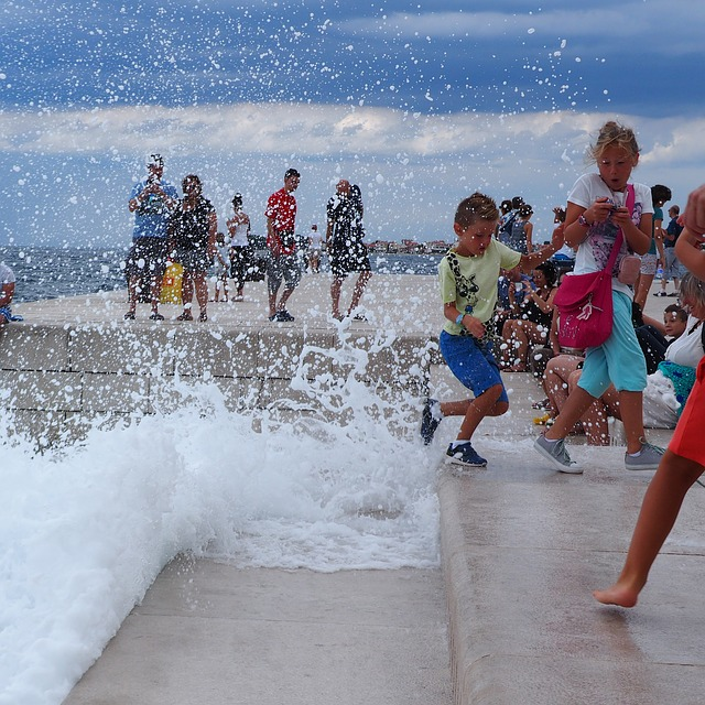 Children playfully splash on the edge of the sea