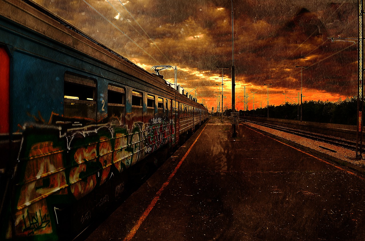 A train moves away in a grim, dark-orange polluted landscape