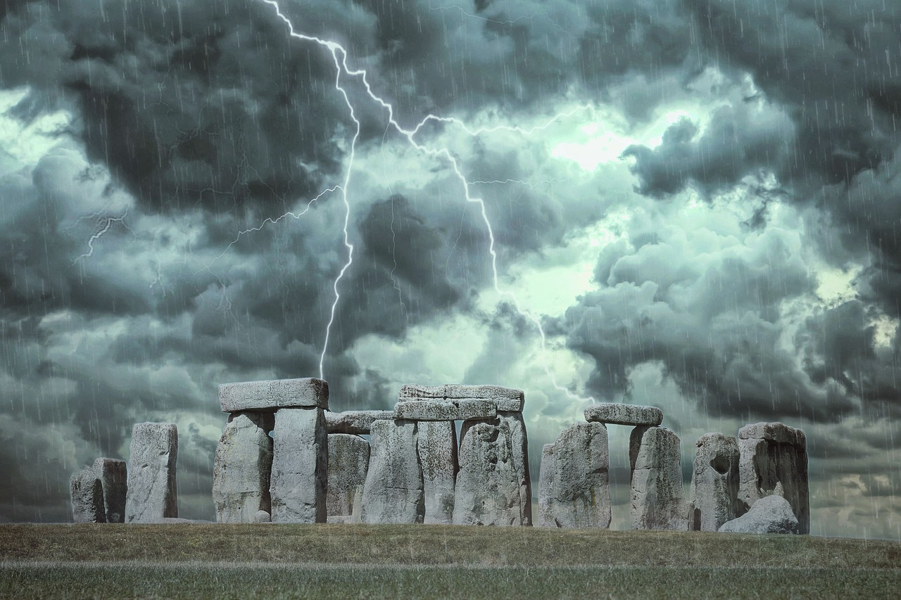 Stonehenge megaliths against a stormy background