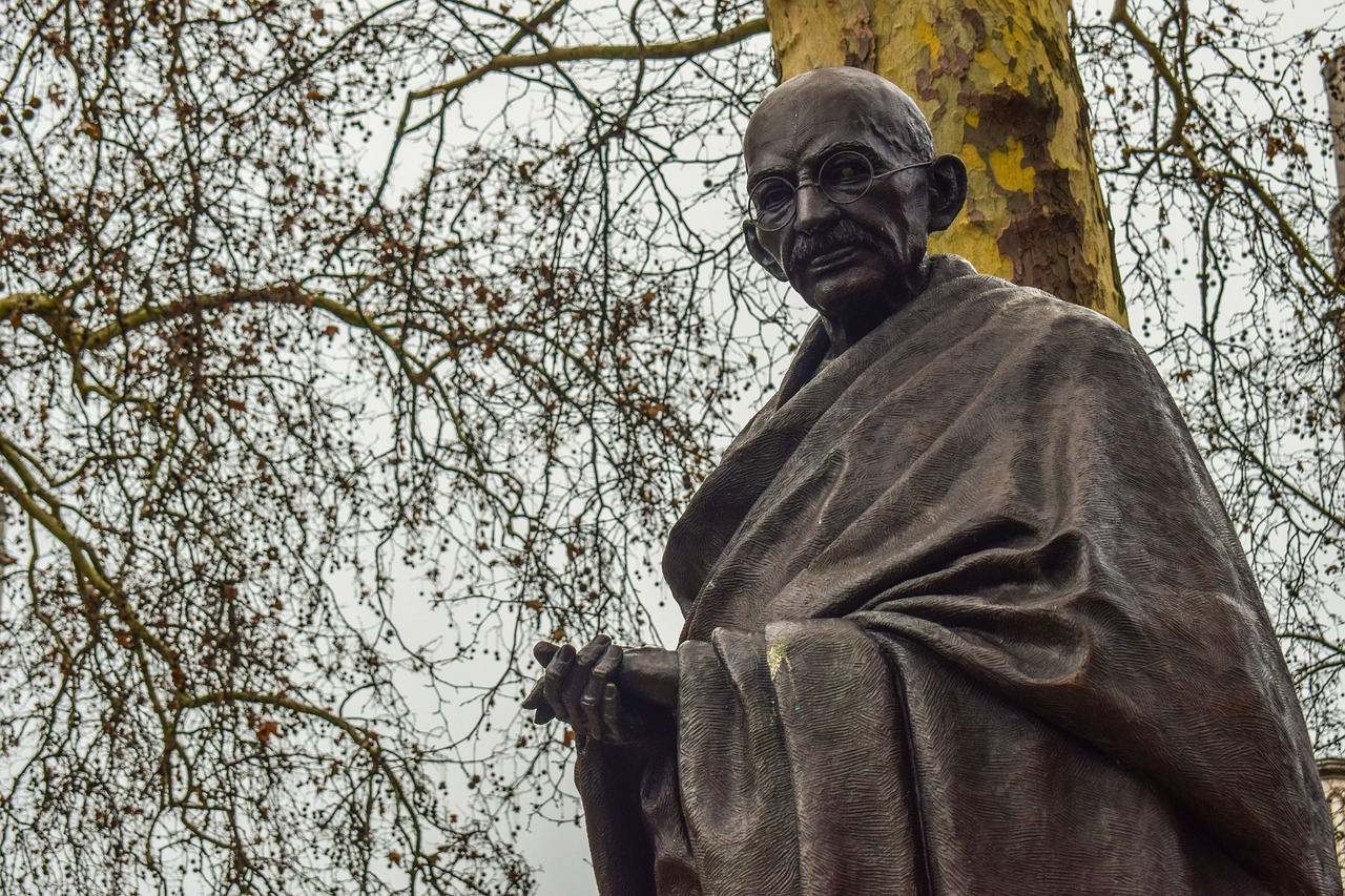 Statue of Mahatma Gandhi, with a tree behind it